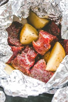 Delicious steak & potatoes recipe! Seasoned with garlic and herbs, then cooked inside foil packets this recipe is perfect for camping, grilling or the oven. #steak #potatoes #foilpacks #camping #grilling #cookout #outdoorcooking