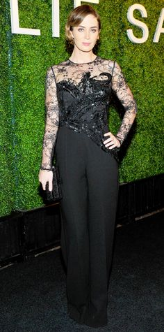 Emily Blunt smoldered at a dinner hosted by designer Elie Saab in a black lace long-sleeve Elie Saab jumpsuit with an embellished bodice, complete with a black Rodo clutch and black L.K. Bennett heels. - Look of the Day - November 14, 2014 - Emily Blunt in Elie Saab from #InStyle