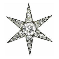 An antique diamond brooch - Designed as a star set with old-cut diamonds, mounted in silver and gold, 19th Century, 3.7 cm.