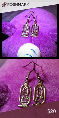 """Sterling Silver Egyptian Cartouche Earrings Sterling silver hieroglyph earrings. I purchased these sometime in the 90's and have not worn them since my 1st husband passed. They need a new home and love again. Length of the cartouche is 1 3/4"""". Marked Sterling silver. Jewelry Earrings"""