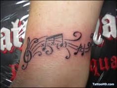 music tattoo...I would make a few alterations but I like this one