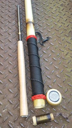 """Bamboo wading Staff with a rod inside plus line and flies. A very classy poachers """"walking stick!""""  Made of natural MosoBamboo the bottom of the staff is weighted internally with lea…"""