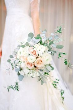 Brides: Rose Bouquet with Eucalyptus and Jasmine. Jasmine and leafy eucalyptus f… Brides: Rose Bouquet with Eucalyptus and Jasmine. Jasmine and leafy eucalyptus freshen up this classic blush and white rose bouquet by… Bouquet Pastel, Ranunculus Wedding Bouquet, Spring Wedding Bouquets, Bride Bouquets, White Ranunculus, White Roses, Blush Bouquet, Cascading Bridal Bouquets, White Peonies