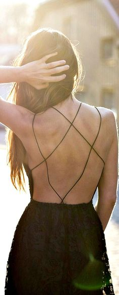 Delicately held. Dress detail. They say that God is in the details. #black #dress