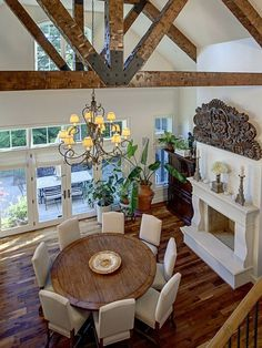Wooden beams in the ceiling, white fireplace, wood distressed table, lots of openness in this room. Makes it feel very cozy.