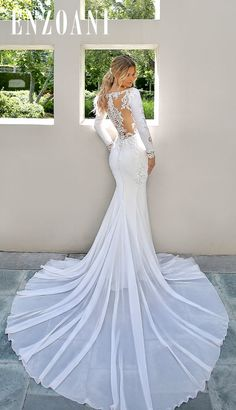 Vintage elegance meets modern glam in this gorgeous mermaid gown. Sleek but supportive stretch georgette is sure to hug all the right curves, while a bateau neckline keeps lines clean and complements . Sleek Wedding Dress, Mermaid Wedding Dress With Sleeves, Top Wedding Dresses, Lace Dress With Sleeves, Mermaid Dresses, Bridal Dresses, Mermaid Gown, Modest Wedding, Red Wedding