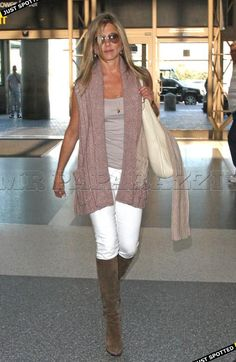 White skinny jeans, brown suede boots and sleeveless knit cardigan