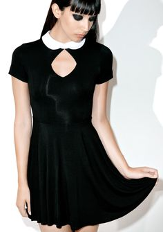 Killstar Bad Habits Dress knows sinning is yer forte. Cuz once a good girl's gone bad there's no turning back, especially in this wicked stretchy dress featuring a stark white Peter Pan collar, keyhole front and cut out back, fit and flare cut, and a pentagram diamond printed on tha back.