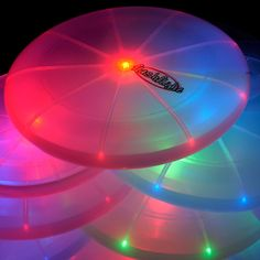 Glow in the Dark toys for guests to play with in the backyard - Frisbee and Kickball.