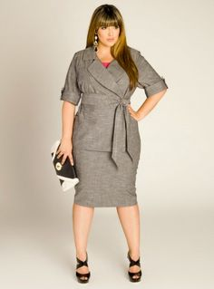 Plus size model Denise Bidot modeling a Cute two piece skirt suit with a black and white clutch