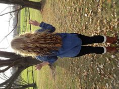 curly hair, chambray shirt, leggings, combat boots with white leg warmers and white infinity scarf