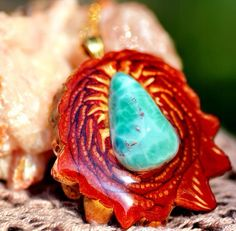 """Larimar // Found only in the Dominican Republic, Larimar is known as """"a stone of answers from the sea of consciousness"""", giving us greater freedom through self-honesty and truth-seeking. It is considered to be excellent for working with sea creatures of all kinds – especially dolphins as well as opening the throat chakra and enhancing communication in general. In ancient folklore, Larimar was used for healing maladies of the throat and upper respiratory system. ( www.thirdeyepinecones.com )"""