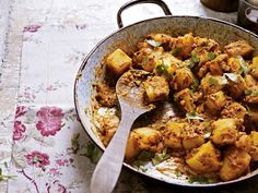 A restaurant dish and probably a hybrid of some of India's more popular home-grown potato recipes.  I have to say this dish beats my own Punjabi cumin potatoes, and it goes with almost everything.