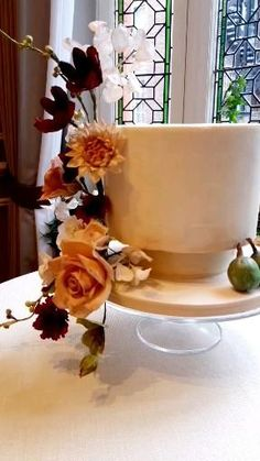 Delicious chocolate cake layered with salted caramel and buttercream. Stone effect cake decorated with beautiful sugar flowers in autumnal colours. #weddingcake #moderncakedesign #prettycakes