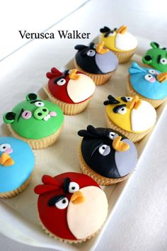 Angry Birds cupcakes by Verusca Walker.  I know one little girl who would love these and would be able to make them look just like this.
