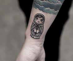 Russian nesting doll tattoo on wrist by Joice Wang