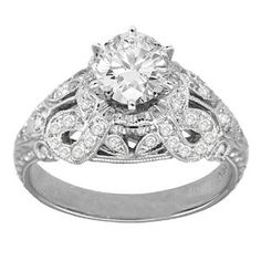 Wide-banded filigree engagement ring... Tori insists.