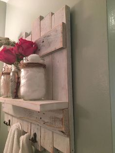 Rustic Towel Rack made from pallet wood, painted and distressed to a white-washed finish with bronze hardware. Definitely one of my best sellers!!!! Could also be used as an unique jewelry display. Measurements 24x 22x 4 Our items are made with reclaimed/re-purposed wood, so there