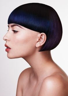 Stunning Avant-Garde hairstyle with perfectly straight bangs and an amazing transition in colors from blue to subtle purple through out her gorgeous black hair.