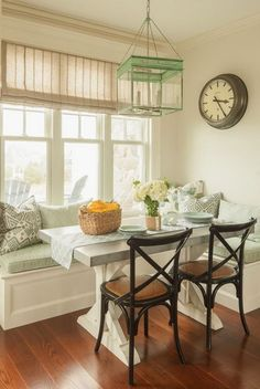 Light green Themed Breakfast Nook.- looks pretty much like home! like those small French dark chairs