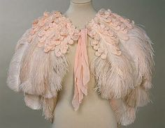 Pink chiffon and ostrich feathers cape worn at the Coronation of George VI, 1937, and later at the Buckingham Palace Ball.