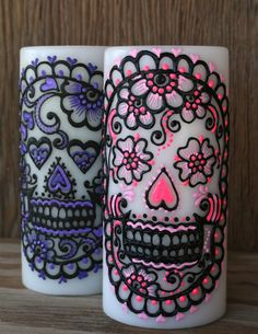 Set of 2 Sugar Skull Pillar Candles, Pink and Purple, Day of the Dead, Dia de los Muertos. $55.00, via Etsy.