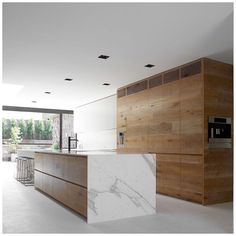 One of my favourite architecture firms has designed the ultimate kitchen creating complete balance and harmony using oak limestone and marble finishes.  It's all about Open Plan Living so be sure to check out my article on @the.tailored.man (link in bio)  Dale Residence By Robson Rak Architects @robsonrakarchitects #dale #robsonrakarchitects #robsonrak #kitchendesign #timber #marble #interiorarchitecture #interiordesign #architecture #interior #design #archdaily #archilove #architecture…