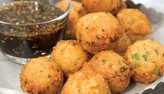 Okra and Corn Fritters with Herb-Pepper Cane Syrup recipe: These are made just like what we call Hush-puppies we fry as a side dish for Fish fries. These are really good served as a appetizer or with any fried meat dishes. Dipped in Cane syrup makes these mouthwatering.