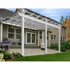 New England Arbors W x L x White Plastic Attached Pergola at Lowe's. Match the grand designs of your home with the stately architecture of the Valencia Pergola. A full sixteen feet of frontage provides your family and Diy Pergola, Pergola Canopy, Pergola Swing, Deck With Pergola, Cheap Pergola, Wooden Pergola, Covered Pergola, Outdoor Pergola, Pergola Shade