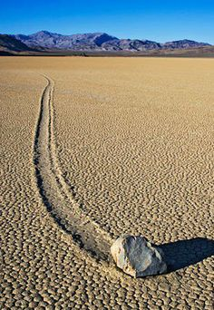 Even NASA cannot explain it. It's best to gaze in wonder at the sliding rocks on this dry lake bed in Death Valley National Park. Racetrack Playa is almost completely flat, 2.5 miles from north to south and 1.25 miles from east to west, and covered with cracked mud. The rocks, some weighing hundreds of pounds, slide across the sediment, leaving furrows in their wakes, but no one has actually witnessed it. — with Terry Lee Lawrence. Like · Comment