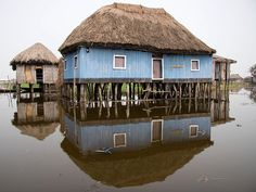 Ganvie, Benin - The village was established in the sixteenth or seventeenth centuries by the Tofinu people, established on the lake because the Dahomey's (a slave trading tribe) religion forbade the Fon warriors from entering water, therefore the lagoon was a safe territory for other tribes.