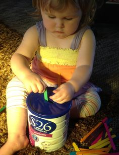 One old tin of formula cleaned, pop a hole in the lid, then give bubba some coloured sticks! Lots of fun as it makes a noise when put in, then empty and start again! Bridget was quiet for nearly 2 hours!
