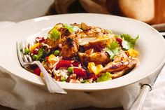 Sticky Spanish chicken and rice----Sail into the week with this easy dish that's a winner with the kids. Honey-glazed chicken is heaven on rice jazzed up with vegetables and almonds. Cook: 0:30, Serves: 4, Rated: 4/5 stars by 23 people.