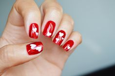 Valentine's Day Nails - White hearts and red glittery polish. Check out more on http://ducklingtoswan.com