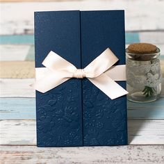 Folding wedding invitation with ribbon bow in navy - more colors available! #wedding #lasercut #invitation #weddinginvitation #laser