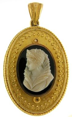 Victorian onyx cameo set in an 18k setting accented with granulation.