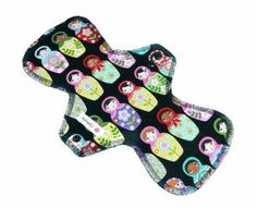 This pad is topped plush black bamboo velour and has an absorbent core of 2 layers of heavy bamboo fleece. Fully lined with PUL for leak protection. Backed in a colourful quilters cotton featuring Babushka Dolls.
