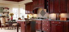 Are those cherry cabinets with brushed nickel hardware? Be still my heart.