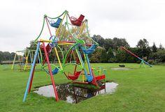 "Vintage playground ferris wheel / merry-go-round - Very cool playground Ferris Wheel. By riding the ""bikes"" you can make the wheel turn around. Buurse - The Netherlands (Photo: Ilse Gerritsen)"