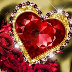 A BIG RED HEART WITH A GOLD TRIM AND JEWELS AROUND IT.