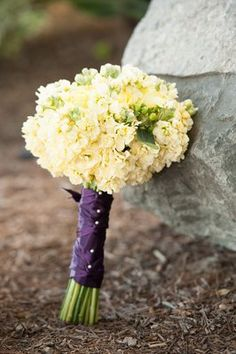 Yellow stock and rose bouquet.