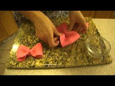 """This will give you a quick and very basic example of how to make a fondant bow. I make my bows from 3 parts Gum Paste to 1 part Fondant. Here is the size I used again in case you missed it: 11"""" long by 3"""" wide - Actually - I made a 12""""x 3"""" long piece, and then cut off a 1"""" piece so that the final piece is 11"""" x 3"""" long. Make sure to let you..."""