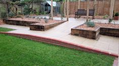 Professional landscape gardening business offering garden design, landscaping and structural garden makeovers specialists in flint work and Indian stone. Landscaping On A Hill, Privacy Landscaping, Landscaping With Rocks, Porch With Ramp, Tiered Landscape, Front Yard Patio, Porch Styles, Sloped Yard, Backyard Layout