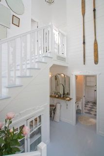 Hanging oars. More here: http://www.completely-coastal.com/2009/02/decorating-nautical-with-wooden-oars.html