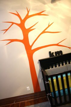Lucy's room is orange and pink so I could do a pink tree on orange or vice versa... I also have paint chips in the color family so we could do leaves. She could help decorate them when she's a little older :)
