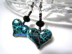These fun and flirty heart earrings are just perfect for Valentines Day.    Shiny and light acrylic heart beads feature a graphic edginess