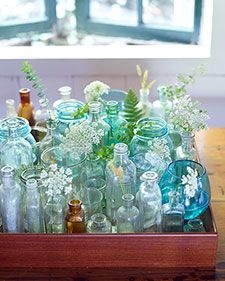 Collect your own bottles of various shapes and sizes over time (mustard jars, perfume bottles, and jelly jars all work well) or salvage some for just pennies at thrift stores. 2. Randomly fill some of the containers with leaves and flowers and place them on a serving tray or platter, packing the jars tightly together. Cost: $0