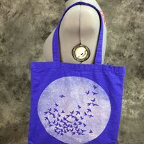 Bleach Dyed blueberry bag with a Sun & Birds design on it. Different design is dyed on both sides (see photos). Perfect for festivals, concerts, conventions, as a reusable shopping bag or as a purse.  Blueberry (Blueish purple) 100% cotton canvas promo bag (thinner than reg. canvas bags from th...