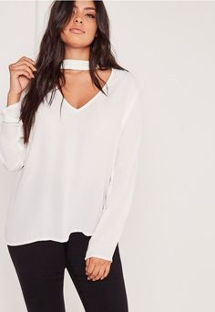 Ensure all eyes are on you this season in this floaty blouse. White is casual, yet always so super classy, and we think you'll look fierce in this! with an on trend choker neck, plunge neckline and long sleeves, you'll look seriously bangin...