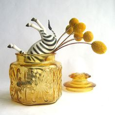 super cute way to shoot a vintage glass jar : shame the upside down zebra doesn't come with it